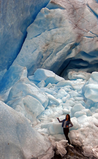 Student infront of a glacier in Alaska