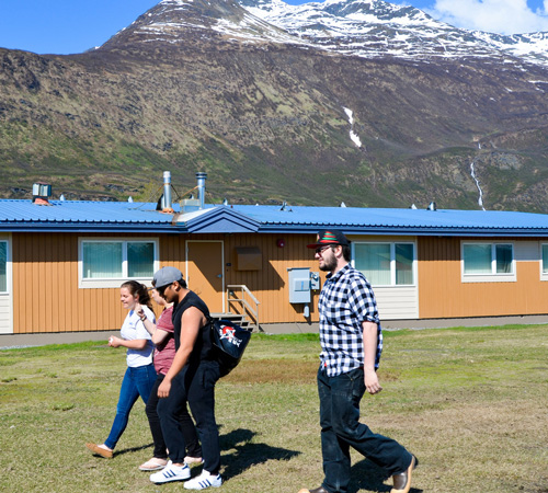 Prince William Sound College students walking infront of student housing in Valdez, Alaska
