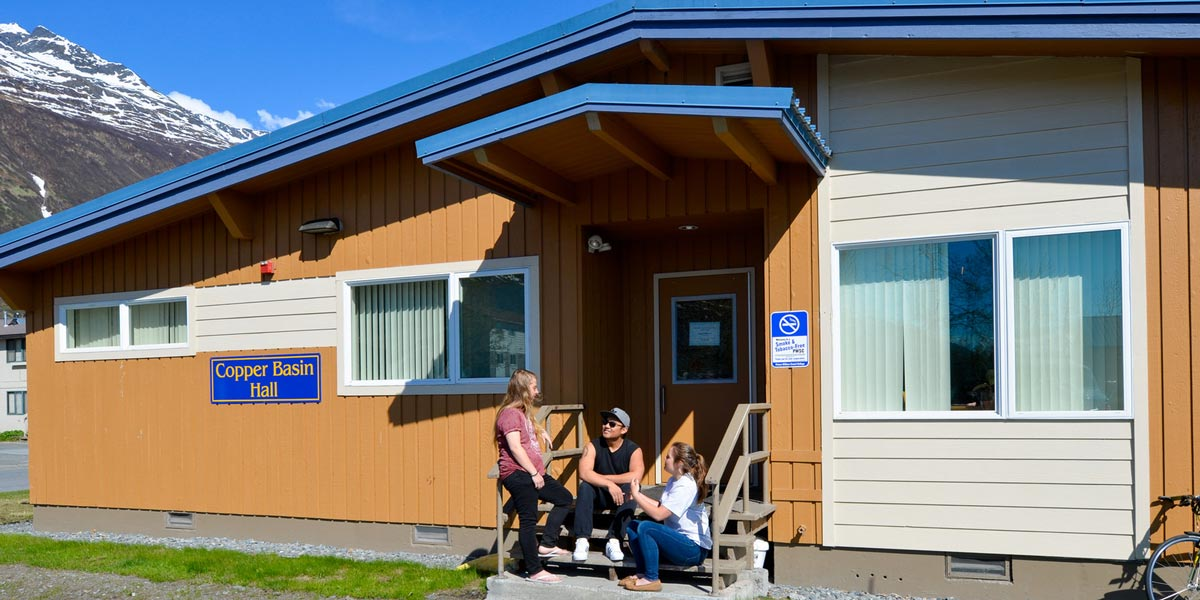 Students infront of student housing at Prince William Sound College (PWSC) in Valdez, Alaska