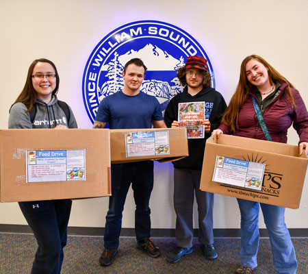 PWSC students hold up boxes being used to collect food donations