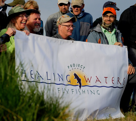 Healing Waters sign with participants