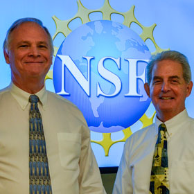 Dan O'Connor and Steve Johnson in front of a National Science Foundation logo