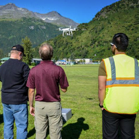 Students fly a drone outside of Prince William Sound College