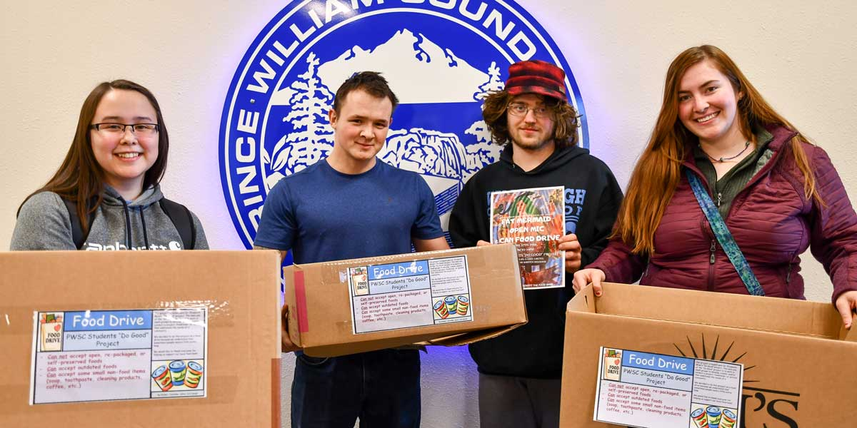 PWSC students holding boxes to collect food donations