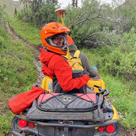 Joe rides on all terrain vehicle in Wrangell St. Elias National Park